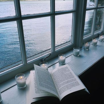 Beautiful boathouse windows overlooking the Tamar River in Tasmania, a beautiful reading spot