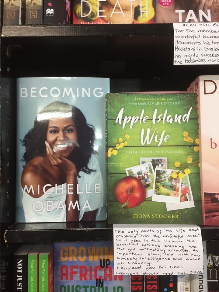 A copy of Apple Island Wife on the shelf in a bookshop