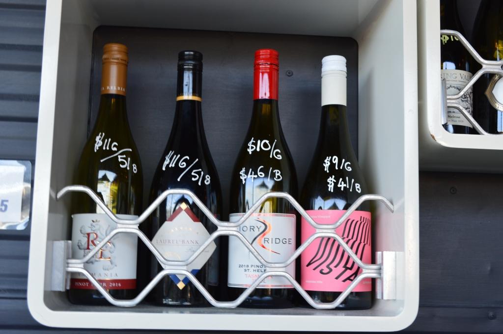 Four bottles of Tasmanian wine displayed in a wine bar