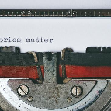 A typewriter ribbon and the words 'Stories matter'